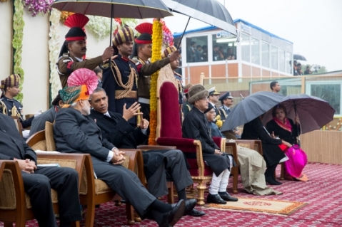 President Barack Obama speaks with Prime Minister Narendra Modi during the Republic Day Parade at the Rajpath saluting base in New Delhi, India. January 26, 2015. (Official White House Photo by Pete Souza)